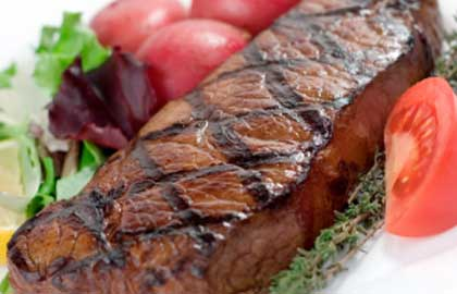 Steak served with a side salad